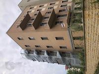 Fluchtspindeltreppe mit Eckpodeste, Dreipunktanschluss am Gebäude